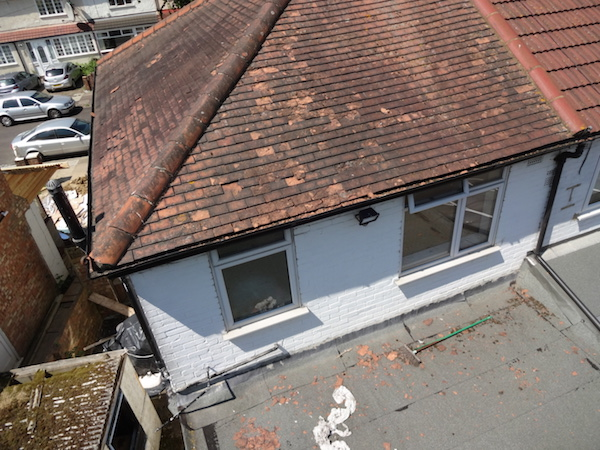 Aerial view 360 photo gutters full of tile debris