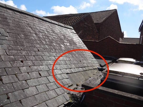 drone shows missing slates to roof